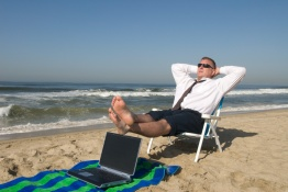 Businessman on beach relaxing